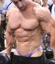David Gasser at Fitness Expo wearing posing trunks underneath