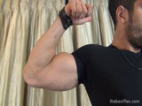 Muscular guys flexing