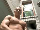 Younger Mr Perfect Pecs posing outside