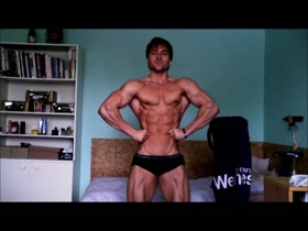 Handsome Bodybuilder Posing and Flexing Ripped Muscles