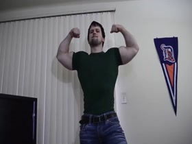 PowerBlue cocky flexing in green shirt