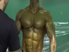 Iranian bodybuilder oiled by roller (WBPF)