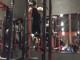 Joshua Vogel pull ups at the gym