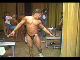 Young bodybuilder pre-contest pumping
