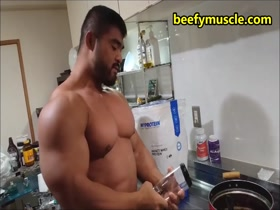 Making protein shake for his massive pecs