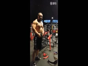 Shirless Asian bodybuilder in the gym