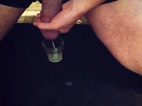 monster cock unloading into a glass with  excess jizz