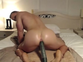 Muscle Hunk fucked by Cucumber