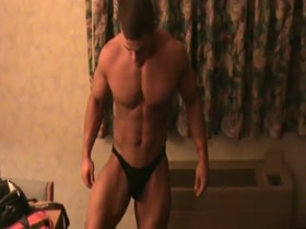 Tanner Parkes posing for a fan in a hotel room