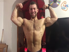 Hot and Vascular muscle guy flexing hard