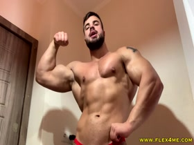 Big Muscles Oiling up and Flexing Hard
