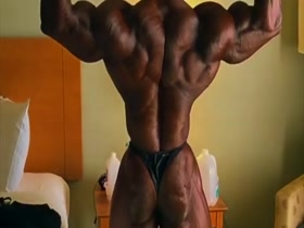 muscle man in tiny posing suit