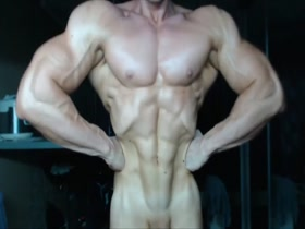 Young muscle posing nude on camera