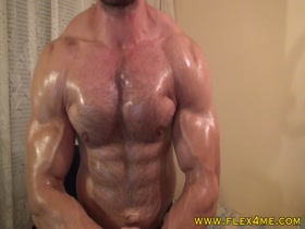 Hairy muscles oiling up