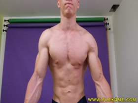 Ripped and veiny young muscle stud pumps up