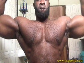 Big Massive black guy flexing hairy muscles