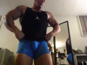 kevin blake flexing in blue spandex tights