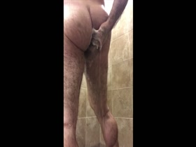 hairy bodybuilder takes a shower