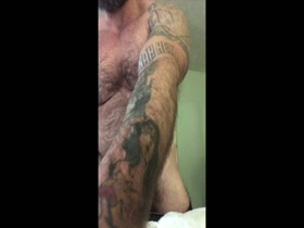 hairy bodybuilder jerks off