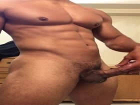 Stunning Muscle Hunk strips down, works his huge cock and cums
