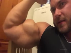 Showing off his huge arms