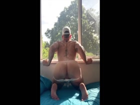 Sexy muscle guy playing with dildo!