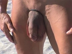 70 Year Old Man Flexing at Beach