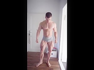 Young bodybuilder poses