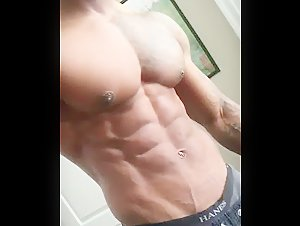 Can anyone put a name to this hot sexy muscle hunk with gorgeous pec and nips?