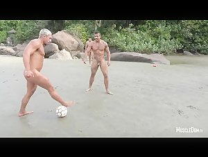 Musclestuds playing Football at the Beach