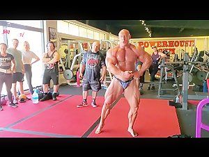 Giant Bodybuilder attracts a crowd at the gym