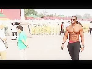 The American fitness Model Ulisses jr Walks on the street shirtless.