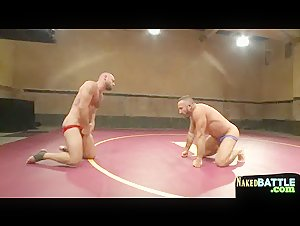 Muscular hunks wrestling naked