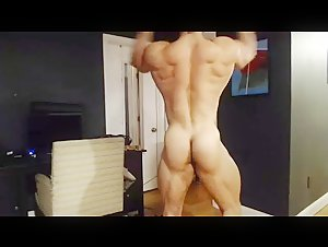 Huge bodybuilder poesing